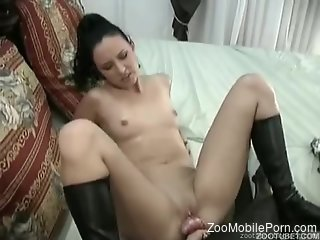 Dark-haired lady in black boots gets fucked by a dog